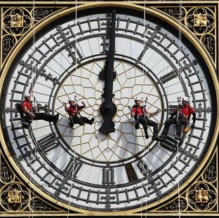 A specialist technical abseil team clean and inspect one of the four faces of the Great Clock, otherwise known as Big Ben, at the Houses of Parliament