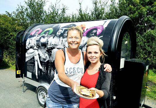 Joanne Haworth and her niece Lilie Eatough outside their Victoriana van