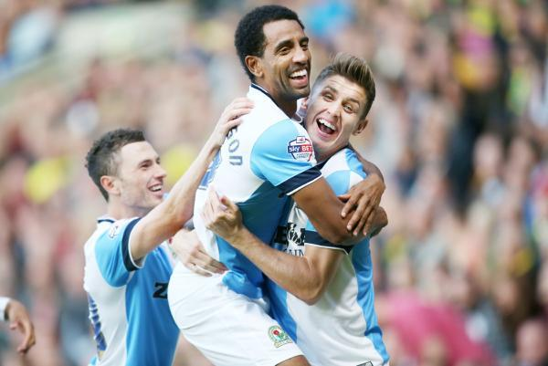 Tom Cairney (right) celebrates his goal at Norwich