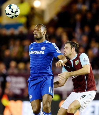 Michael Duff battles with Didier Drogba in Monday's defeat to Chelsea