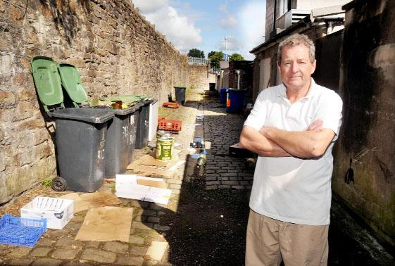 David Leaver with the rubbish left behind the bakery o