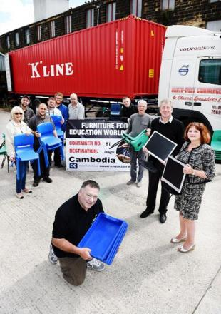 Terry Burns chairman, front, with trustee Julie Cooper, right,  and Coun Mark Townsend, leader of Burnley Council, second from the far right, alongside volunteers as they load the 61st container
