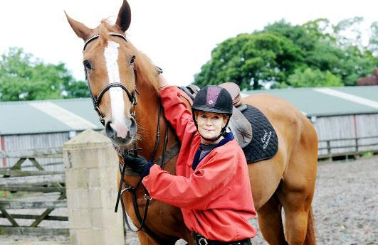 Horse Trainer Carol Richardson from Panama Sports Horses UK based at Gisburn Park, which supplied 10 horses for the 2012 Olympics. She is with one of the horses, The Kings Man