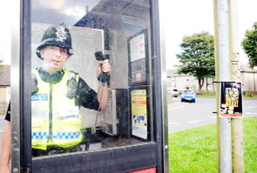 PC Mark Walker at the Burrell Avenue telephone box