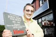 Stonemason Brent Stevenson with the new plaque commemorating the Vimto inventor