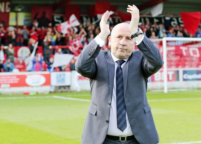 Accrington Stanley manager John Coleman salutes the home fans at the final whistle