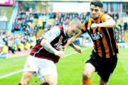 STAR: Kieran Trippier. (left) and Hull City's Robbie Brady challenge for the ball during the Barclays Premier League match at Turf Moor