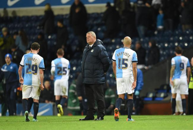 Rovers players cut dejected figures following the late loss to the Owls