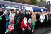 Happy rail travellers get into the festive spirit for the first direct rail journey from Burnley to Manchester.