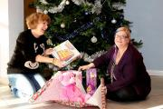 Liz Stanton, Manager and Sarah Bell, Child Support Worker at Clare House wrapping a few of the presents already donated to the Wish Tree at Progress Housing Group's offices in Leyland.