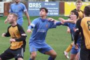 EYES UP: Clitheroe in action during their thumping 6-0 win at Prescot Cables