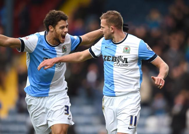 Blackburn Rovers star Jordan Rhodes celebrates his second goal against Charlton Athletic at Ewood Park, with Rudy Gestede