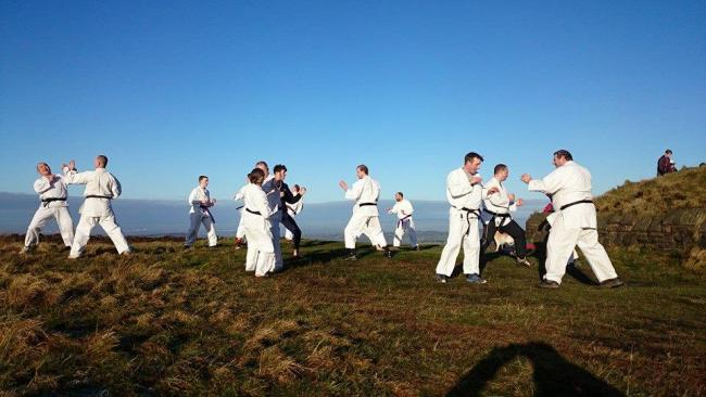 MERRY: Members of Tower Shukokai Karate Club hold their annual training session on the moors at the foot of Darwen Tower