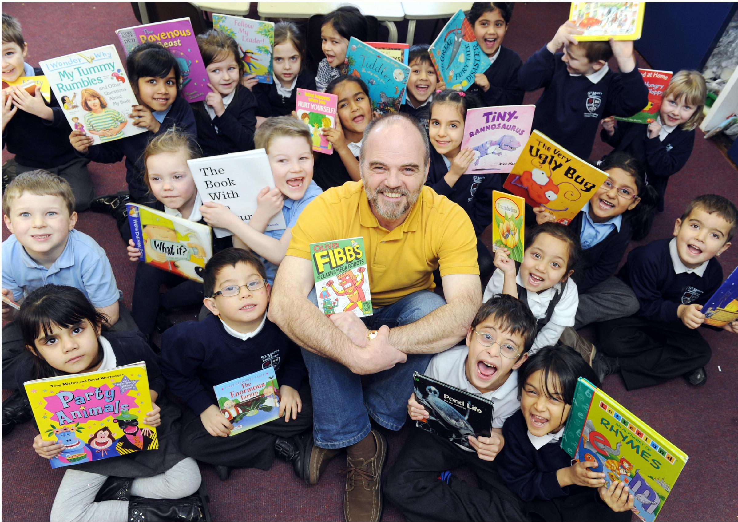 BOOKED UP: Local children's author Steve Hartley is the new patron of reading at St Mary's CE Primary School, Rawtenstall
