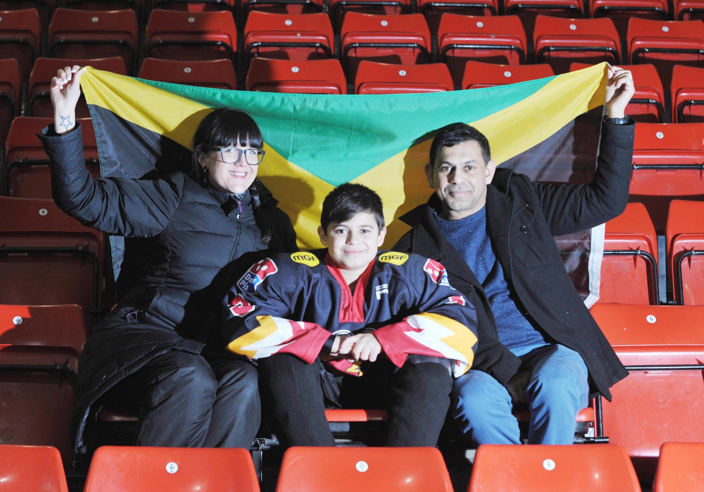 OLYMPIC DREAM: Blackburn Hawks youngster Sol Saddoo, aged 12, pictured with team manager Emma Ludlow and dad James holding the Jamaican flag, hopes to one day compete in the Winter Olympics