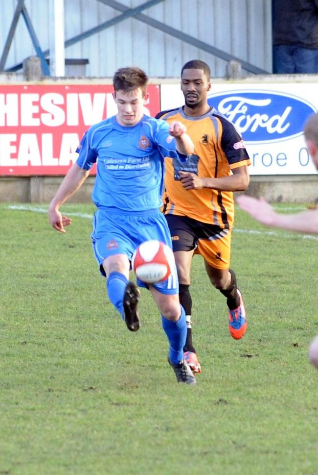 POINT: Clitheroe's Richard Burns looks to make progress in the 1-1 draw with Ossett Albion