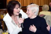 Singer Joyce Kay of Blackburn, is joined on the mike by 89 year old Kathleen Heys of Darwen, during the Good Friends afternoon at Derwent Hall, Darwen.