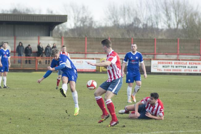 AIM: Ramsbottom's Lee Gaskell tries his luck in the defeat to Witton Picture: ROB MOSS