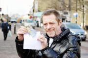 LUCKY: Gud Luck Guy Jimmy Trigg in his hometown of Colne where he leaves envelopes containing lottery tickets for Colne people to find