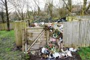 UNTIDY: Rubbish piled high at St John's graveyard. Visitors say the mound has become an eyesore