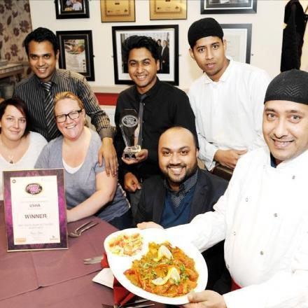 Pictured L-R: (back row): Alkas Ali, Faz Ahmed, Hussain Ali; (front row): Laura Jackson (customer), Victoria Sedgwick (customer), Ibby Ali (owner) Esof Ali (chef).