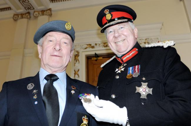 HONOUR: Ken Abbott received his medal from Lord Shuttleworth