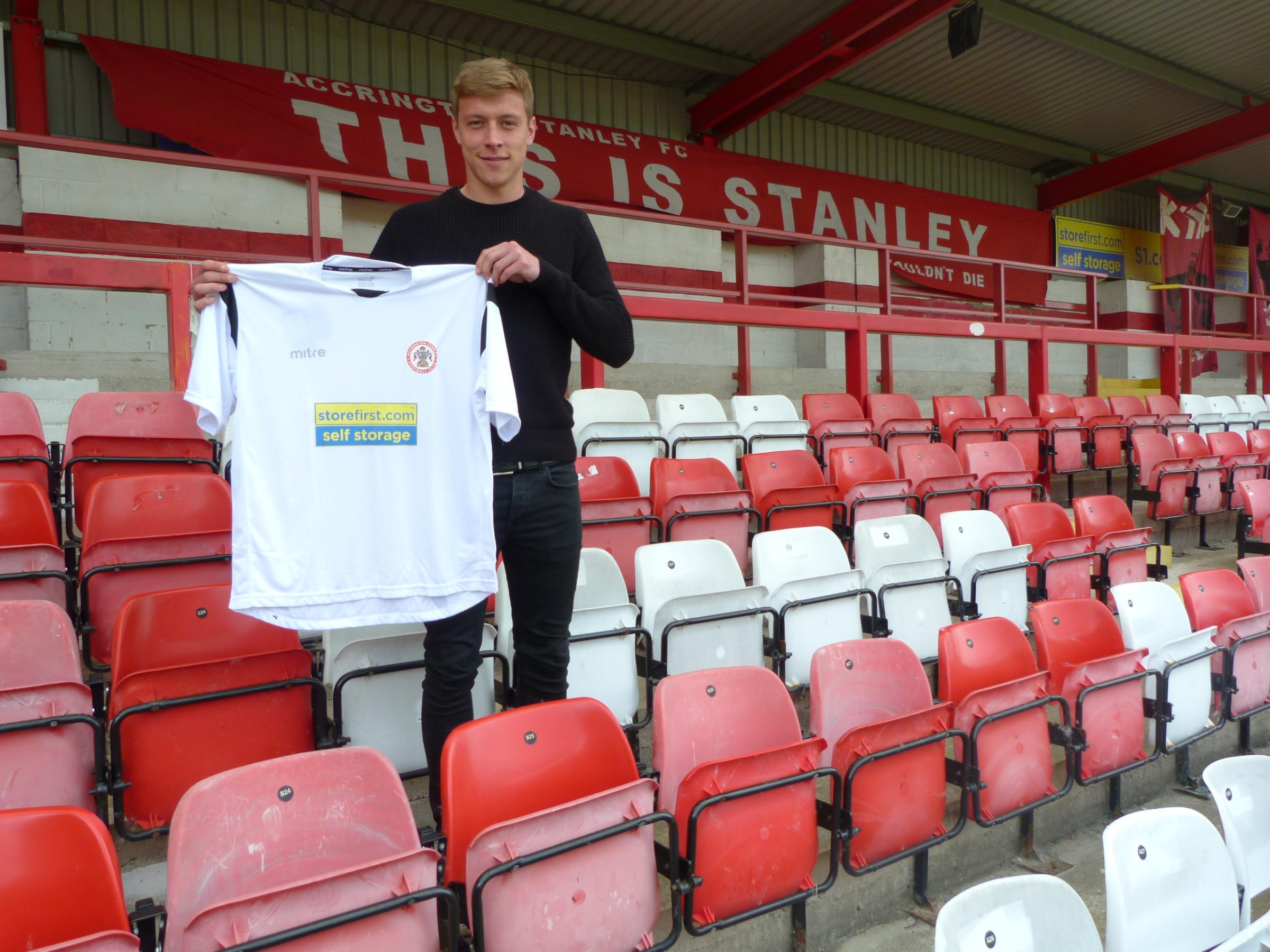 NEW BOY: Tom Davies shows off his Accrington Stanley shirt having penned a one-year deal with the Reds