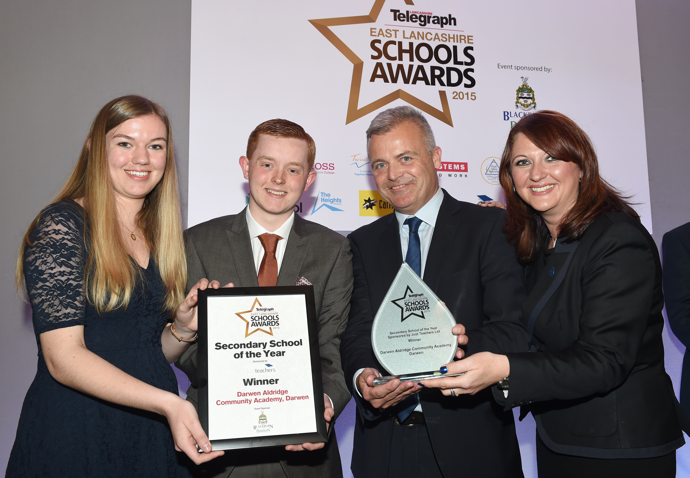 WINNING TEAM: Head girl Ella McLeod and Travis Frain, head boy, with principal Brendan Loughran and Michelle Billington, assistant principal and Secondary School of the Year Award