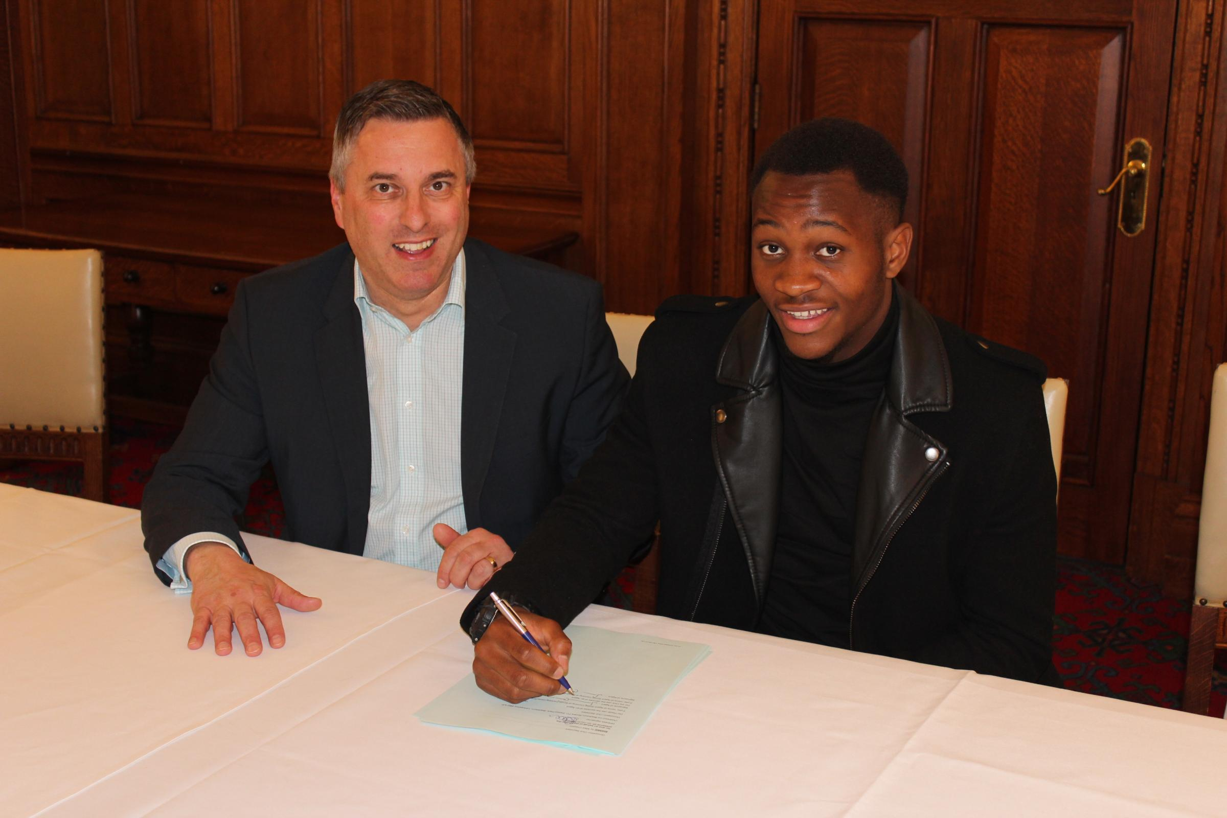 Ryan Nyambe, alongside Rovers football secretary Ian Silvester, puts pen to paper earlier this summer. Picture: BRFC