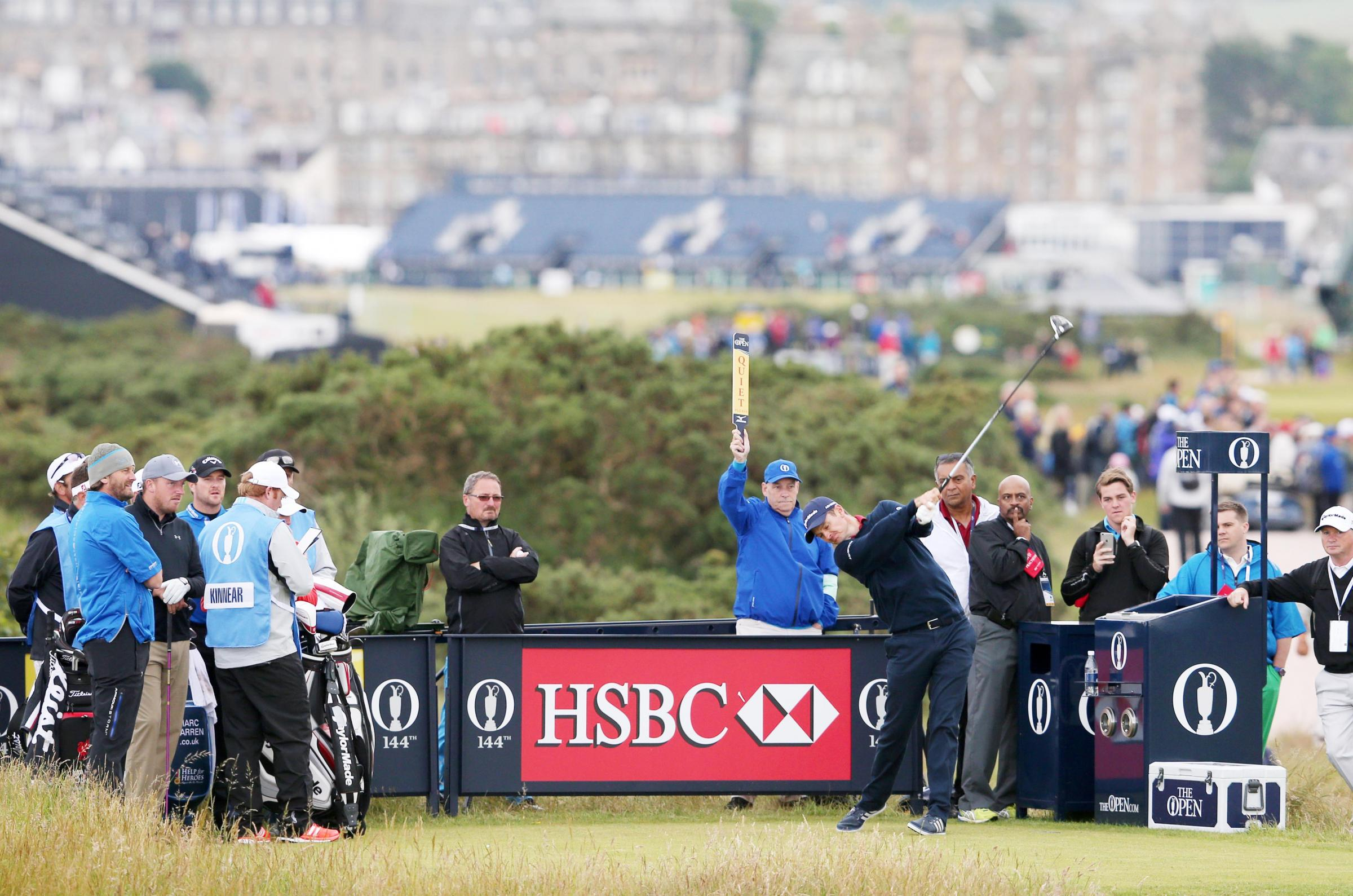 ILLUSTRIOUS COMPANY: Clitheroe's Mark Young (left) watches Justin Rose tee off at St Andrews yesterday
