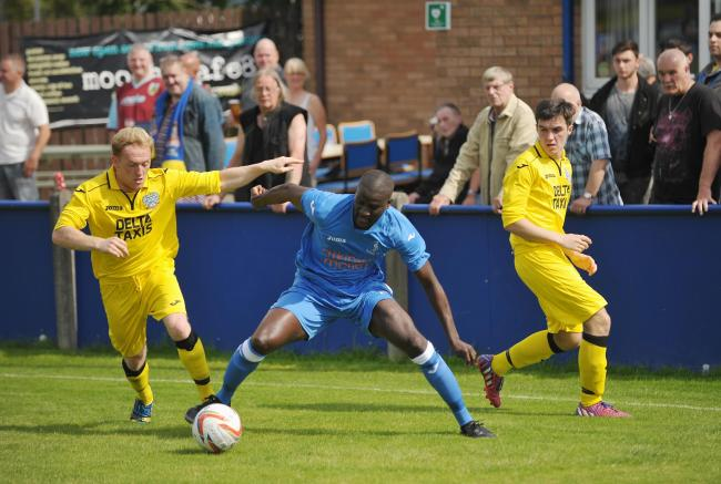 CHARGE: Padiham's Seydou Bamba looks to make a breakthrough during his side's 1-1 draw with Bootle
