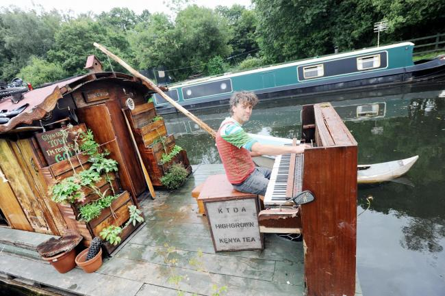 WATER MUSIC: Ben Cummins is taking a piano from Liverpool to London on a raft-like canal boat