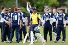 OUT: Cherry Tree celebrate the wicket of Settle professional Imran Khalid      Pictures: KIPAX