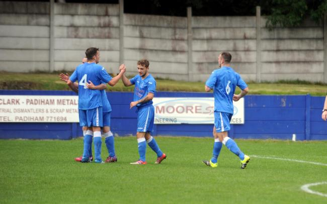 PICK ME UP: Padiham players celebrate Kieron Pickup's first goal Pictures: HELEN BROWN