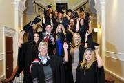SUCCESS: Some of the Accross students and the college dean Charlotte Scheffmann celebrate their success at Accrington Town Hall