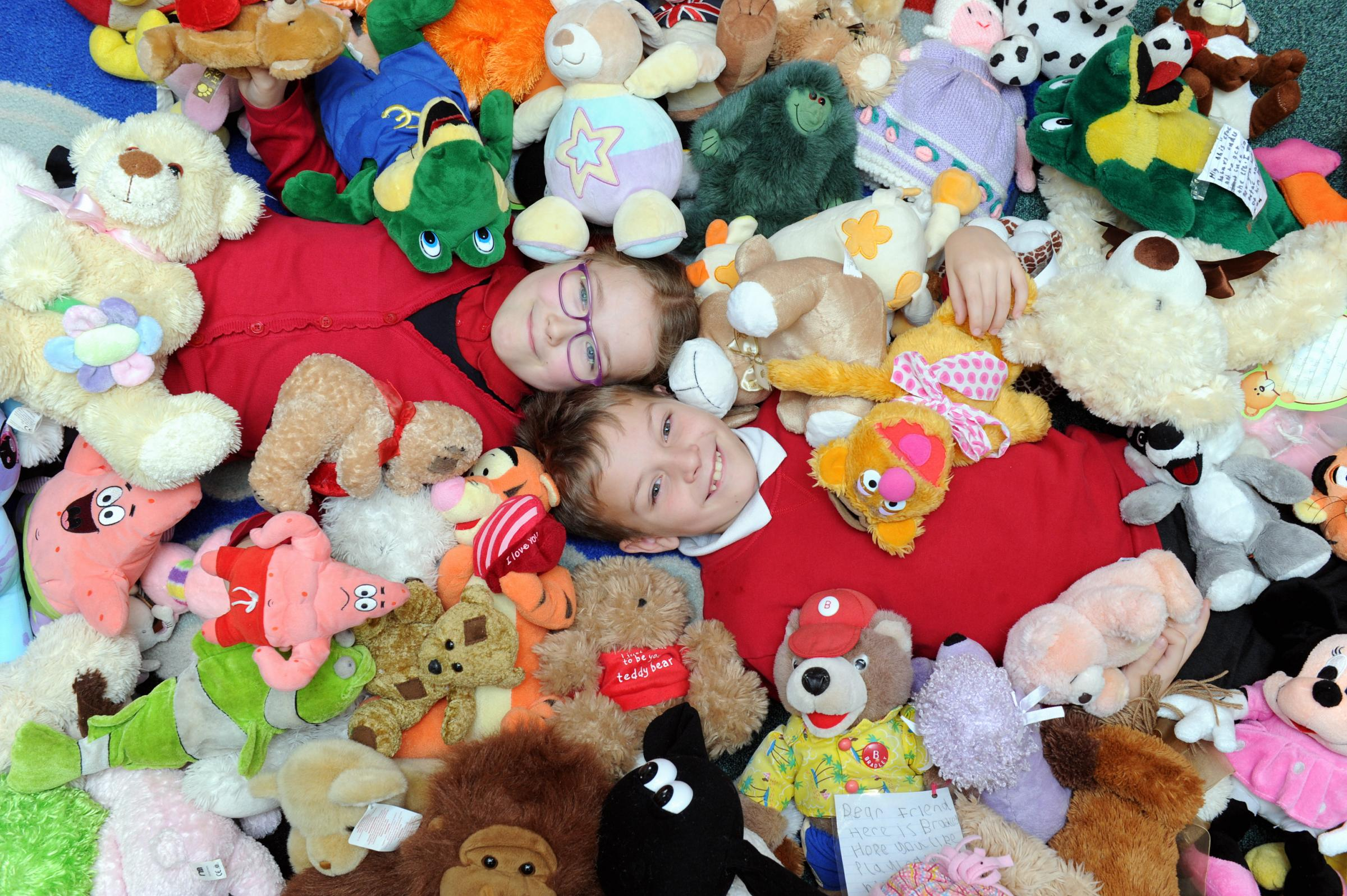 COMFORT: Shadsworth Junior School pupils Sophie Whelan and Charlie O'Neil with the teddy bears        Picture: Paul Heyes