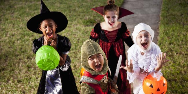Children in halloween costumes.