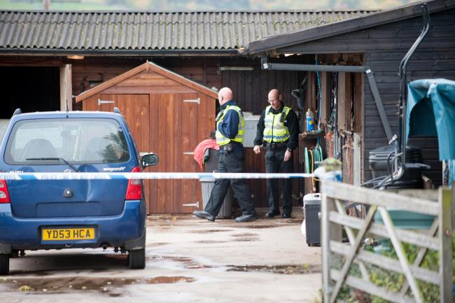 INVESTIGATION: Police officers at the stables in Old Stone Trough Lane, Kelbrook