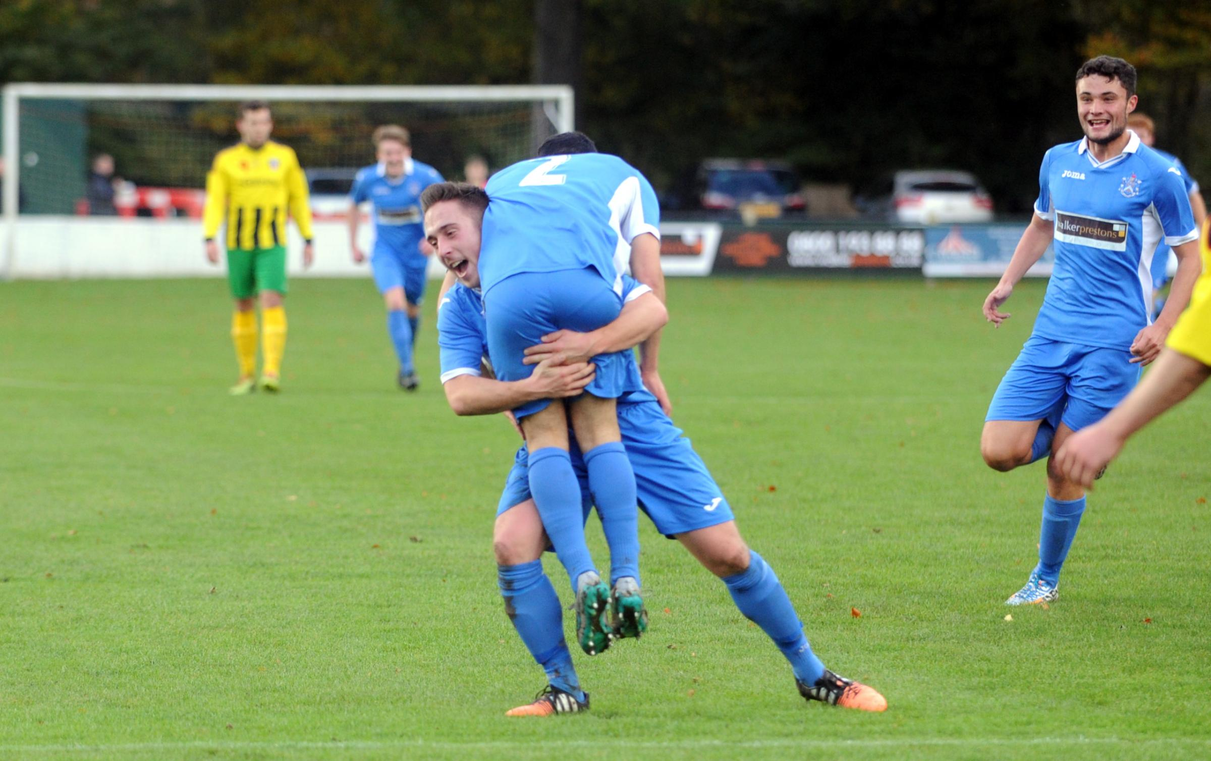 LIFT OFF: Nelson celebrate their win over Congleton