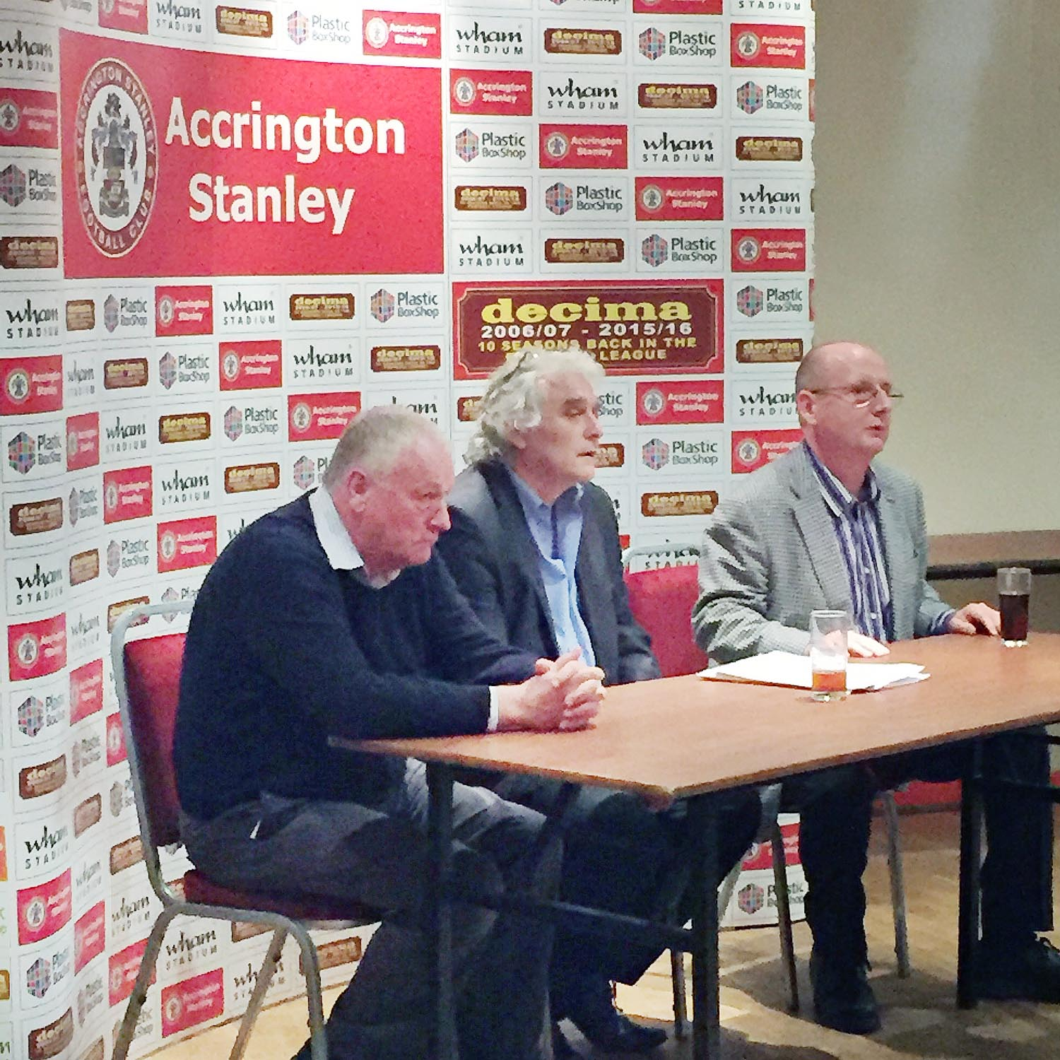 DEAL: Andy Holt (right) during the shareholders' meeting, with Peter Marsden (centre) and Alan Pickup