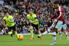 Andre Gray of Burnley scores from the penalty spot