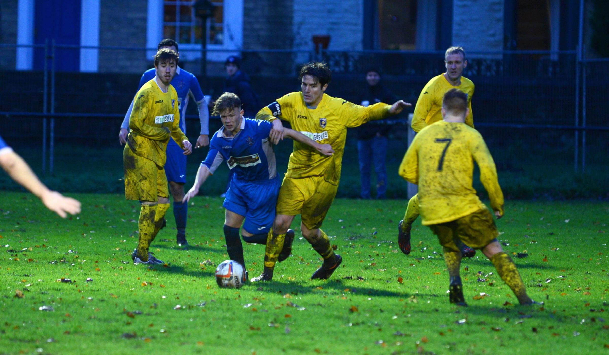 TURNING POINT: Stephen Cassidy tries to escape the attentions of Cammell Laird defenders during Saturday's 4-2 defeat for Nelson