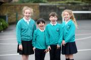 CHEERING: Turton Belmont Primary pupils, Phoebe Wesson, 11, eight-year-olds Isaac Drummond and Fynlay Legood, and Elena Corsan, 11, celebrate the school's achievement in the key stage two SATs