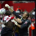 Lancashire Telegraph: HANDS ON APPROACH: Carlo Nash punches clear of Saints striker Kenwyne Jones. Daily Echo pictures by: Paul Collins.