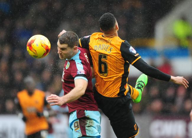 IMPRESSIVE: Sam Vokes vies for possession with Hull City's Curtis Davies during the Clarets' 1-0 weekend win