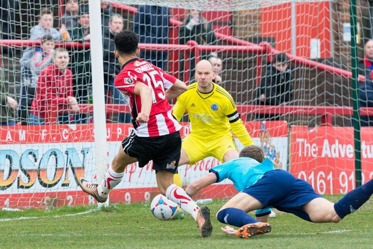 Josh Ginnelly scores Altrincham's second goal after going on a mazy 50-yard run. Picture: Michael Ripley