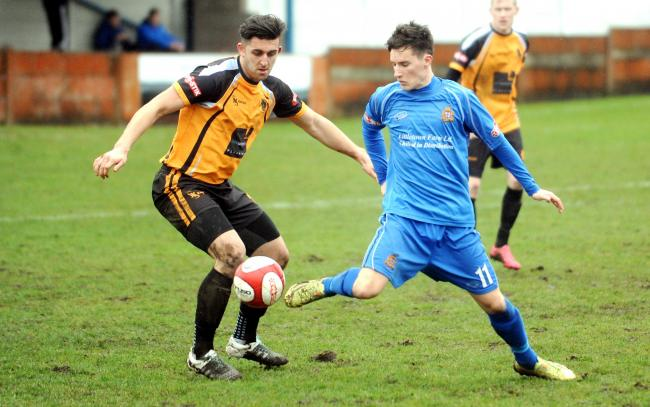 BOUNCE BACK: Clitheroe's Scott Harries in action at Ossett Albion at the weekend