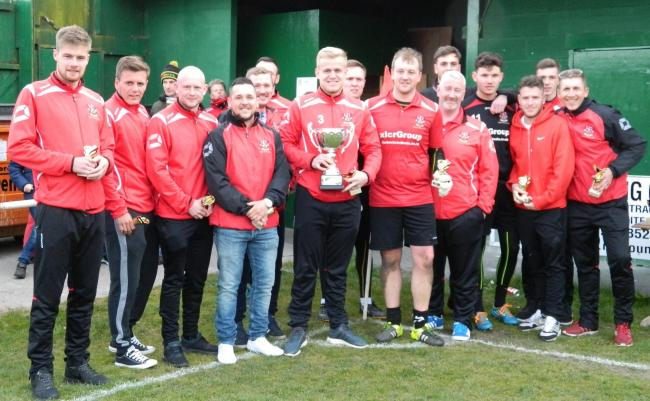 Colne Reserves celebrate winning the Galaxy Lancashire League title
