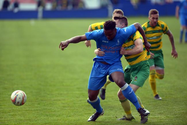 Curtis Haley in action for Padiham against Runcorn Linnets
