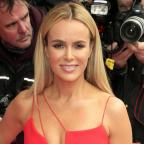 Lancashire Telegraph: Amanda Holden lies naked on a bed of cabbages for Peta